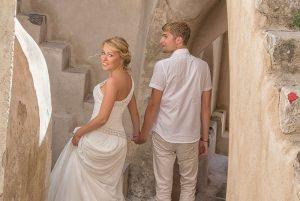 Romantic wedding photos in Santorini Greece by TripShooter's Santorini photographer Ioannis Pananakis