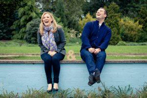 Happy couple laugh on vacation, by London photographer Erika Szostak
