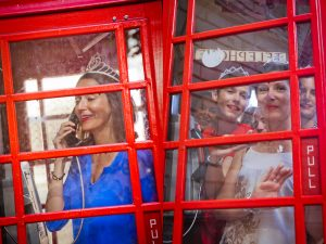 Fun photos in red telephone boxes in London, Brighton and England by London photographer Erika Szostak