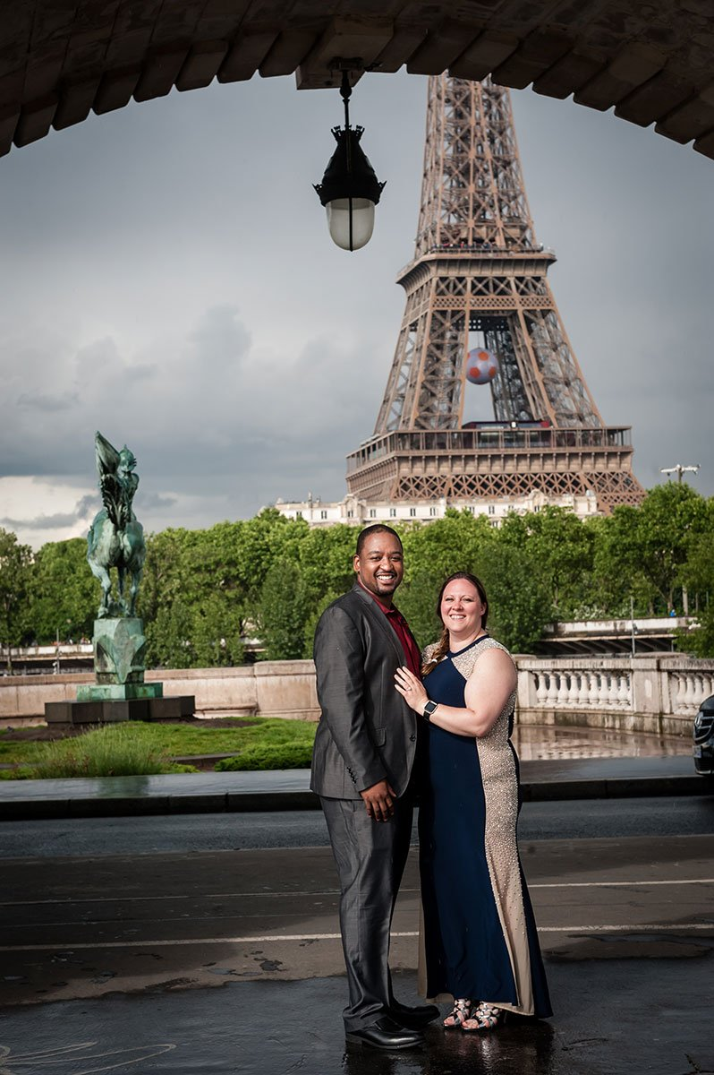 Lovely couple portrait in front of the Eiffel tower by Pierre Turyan